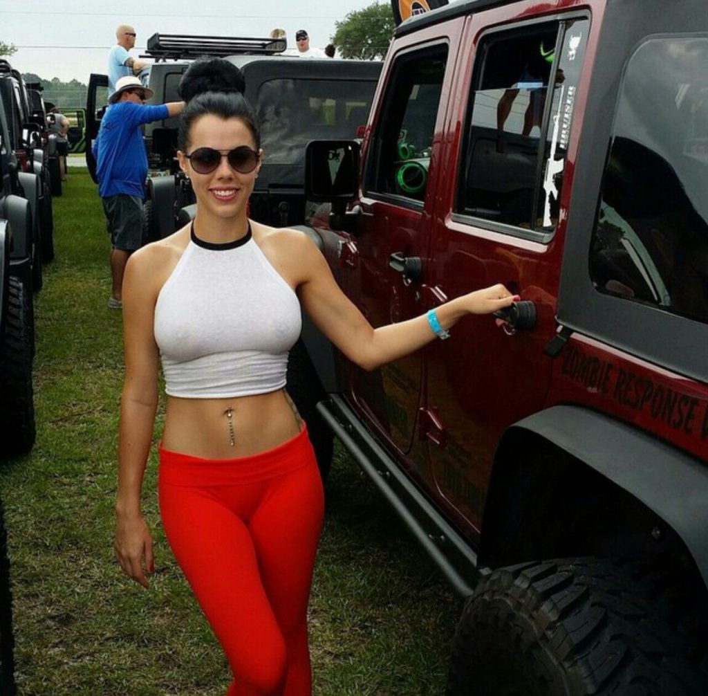 naked girl laying on the back spare tire of a jeep   Dzsipek …